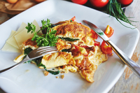 Scrambled eggs with spinach, parmesan & tomato
